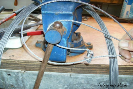 Boarmasters Loading Cable on Vise